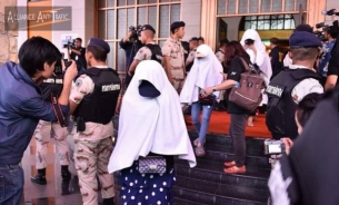 The Department of Special Investigation (DSI) joined with the Army and police to raid a massage parlour in Bangkok's Rama 9 area on Friday over allegations of human trafficking and prostitution of girls under 18.